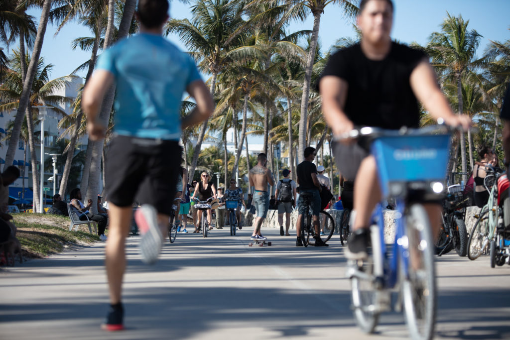 South Miami Beach Ocean Drive Miami Beach Boardwalk Citi Bike People Bicycling Biking Exercising Skateboarding Sunny 20180325 066